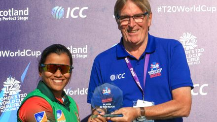Nahida Akter receives her Player of the Match award from Geoff Fisher President of Arbroath Cricket Club.