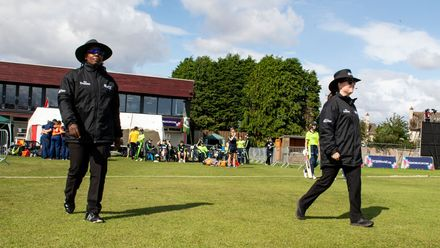 Umpire, Jacqueline Williams, from Jamaica and Umpire, Eloise Sheridan, from Australia take the field.