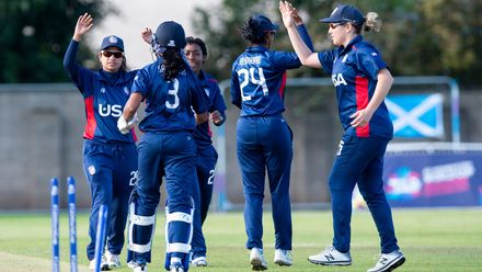 USA celebrate the wicket of Scotland's Becky Glen for 8 runs.