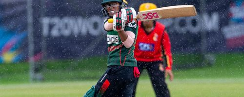 Bangladesh's Fahima Khatun sweeps to third man for 2 as the rain begins to fall.