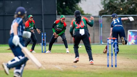 Bangladesh's Khadija Tul Kubra fires the ball down the wicket to run out Scotland's Ruth Willis.