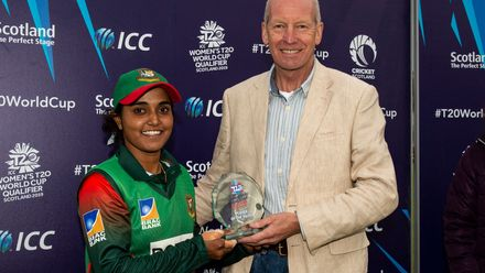 Bangladesh's Nigar Sultana receives the player of the match award from the President of Cricket Scotland, William Donald.