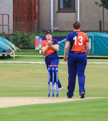 Caroline de Lange takes the catch to dismiss Sune Wittmann.