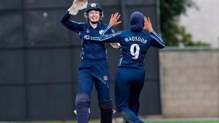 Scotland's Sarah Bryce and Scotland's Abtaha Maqsood celebrate the wicket of Bangladesh's Murshida Khatun for 26.
