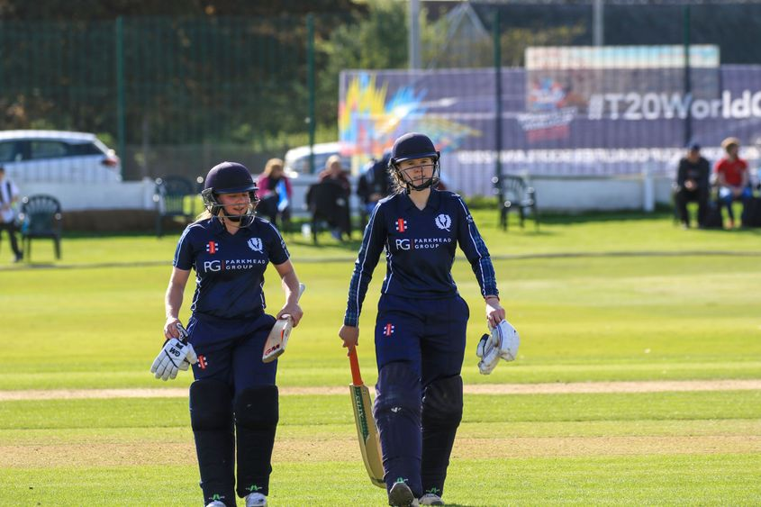 Lorna Jack and Sarah Bryce leave the field after leading Scotland to a 10 wicket win.
