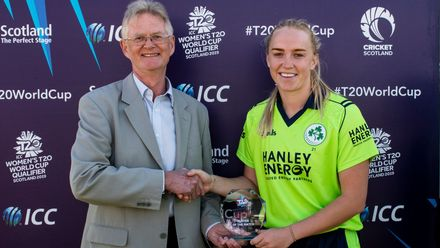 Ireland's Kim Garth receives the player of the match award from the Chair of Cricket Scotland, Tony Brian.