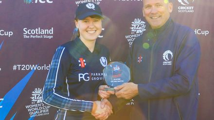 Player of the match Sarah Bryce with her award from Malcolm Cannon CEO Cricket Scotland.