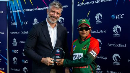 Bangladesh's Sanjida Islam receives the player of the match award from ICC General Manager – Development William Glenwright.