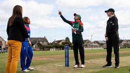 Bangladesh captain, Salma Khatun, flips the coin.