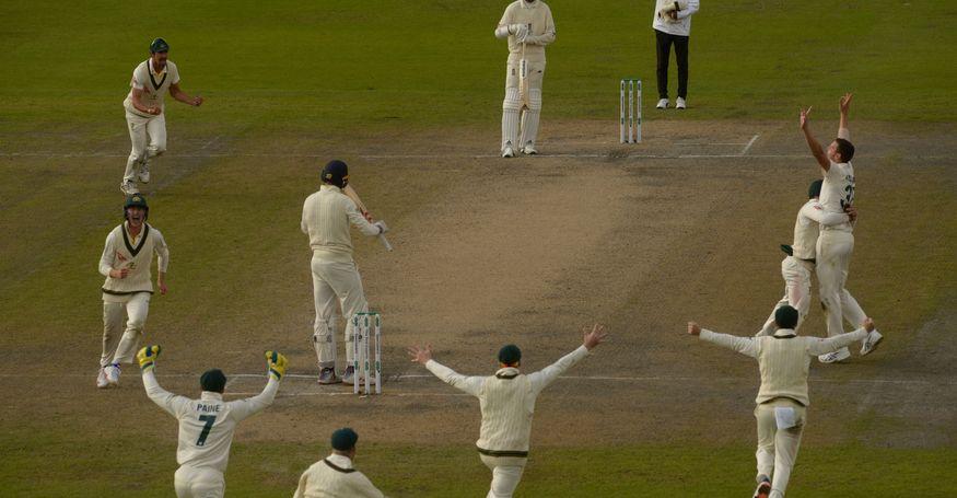 Umpire Kumar Dharmasena raises the finger as Australia rejoice