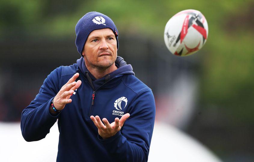 Scotland head coach Shane Burger catches a rugby ball in training