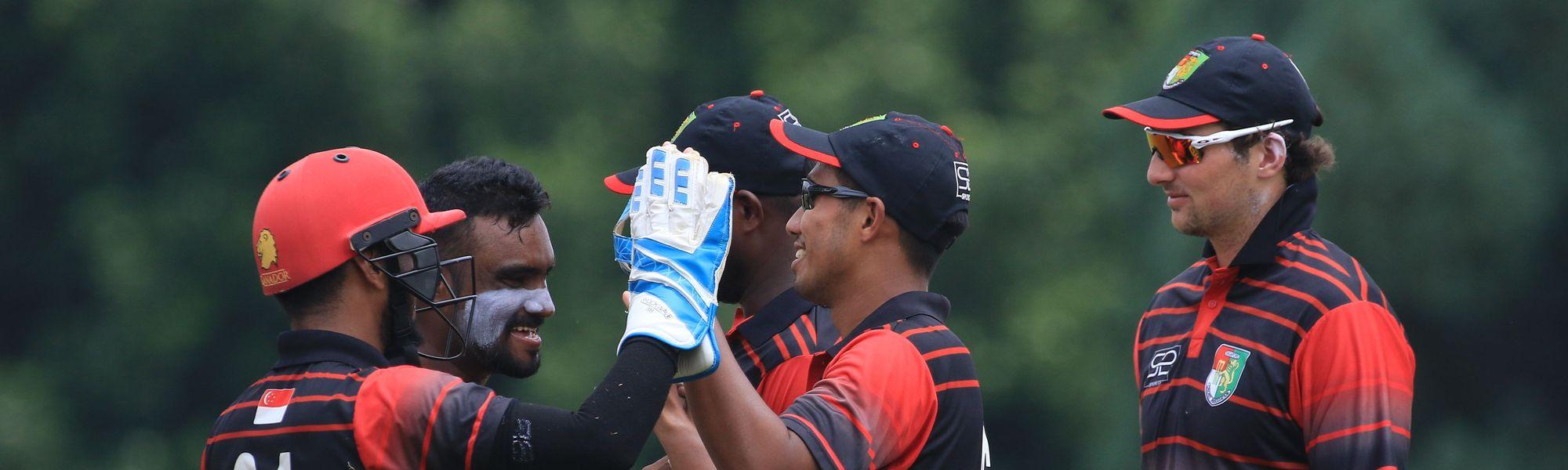 Singapore players celebrates upon dismissing Rodrigo Thomas of Canada.JPG