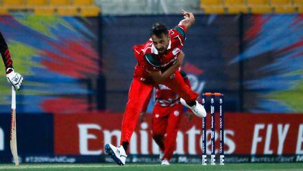 Ahmad Fayyaz Butt bowls against Canada