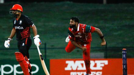 Khawar Ali bowls against Canada