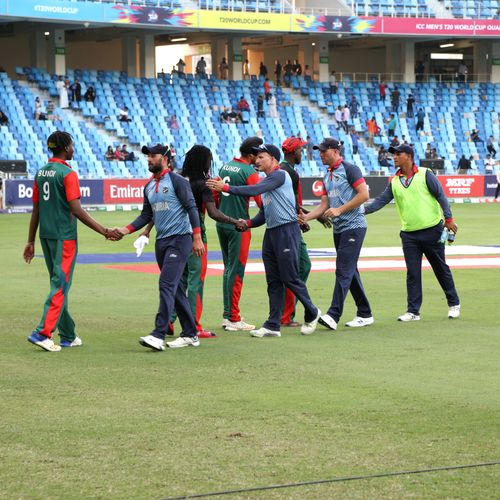 Teams shake hands after the match