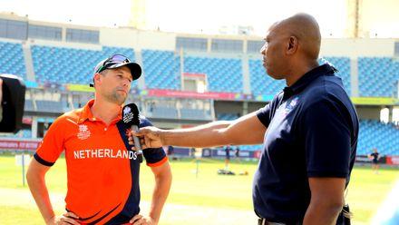 Netherlands Captain Pieter Seelaar speaks to - Ian Bishop after winning the Toss