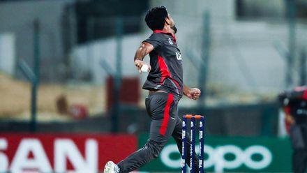 Junaid Siddique bowls against Canada