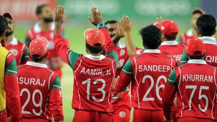 Team Oman celebrate Niko Davin wicket 2