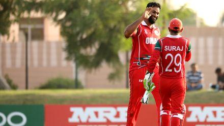 Oman celebrate wicket of Calum MacLeod