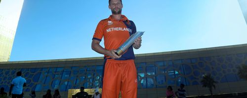 Netherlands captain Pieter Seelaar poses outside the Dubai Frame with the ICC Men's T20 World Cup Qualifier trophy, which his side won with a seven-wicket win over Papua New Guinea.