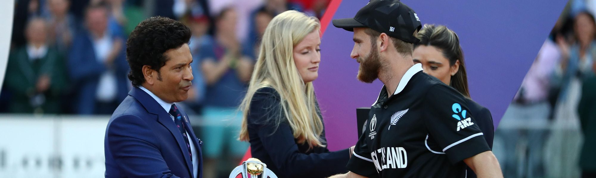 Kane Williamson the New Zealand captain receives the player of the tournament award from Sachin Tendulkar at the presentation ceremony.
