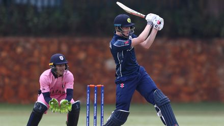 Ben Davidson of Scotland hits the ball towards the boundary, as Marcus Thurgate of Japan looks on during the ICC U19 Cricket World Cup warm up match between Scotland and Japan at St John's College on January 13, 2020 in Johannesburg, South Africa.