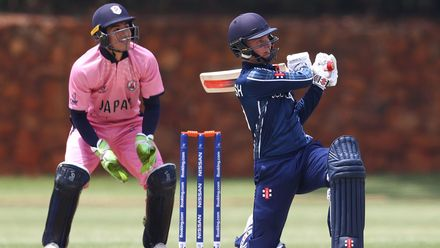 Tom Mackintosh of Scotland hits the ball towards the boundary, as Marcus Thurgate of Japan looks on during the ICC U19 Cricket World Cup warm up match between Scotland and Japan at St John's College on January 13, 2020 in Johannesburg, South Africa.