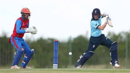 Lewis Goldsworthy of England hits the ball towards the boundary, as Mohammad Ishaq Shirzad of Afghanistan looks on during the ICC U19 Cricket World Cup warm up match between England and Afghanistan at Mandela Cricket Oval on January 14, 2020.