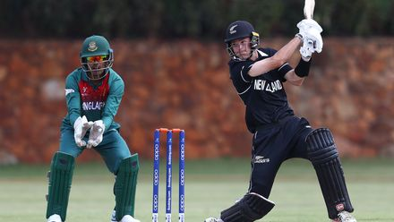 Jesse Tashkoff of New Zealand hits the ball towards the boundary, as Mohammad Akbar Ali of Bangladesh looks on during the ICC U19 Cricket World Cup warm up match between New Zealand and Bangladesh at St John's College on January 15, 2020.