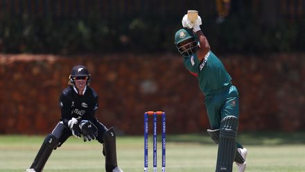 Mohammad Tawhid Hridoy of Bangladesh hits the ball towards the boundary, as Benjamin Pomare of New Zealand looks on during the ICC U19 Cricket World Cup warm up match between New Zealand and Bangladesh at St John's College on January 15, 2020.