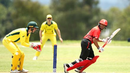Nicholas Manohar of Canada bats with Patrick Rowe of Australia looking on during the ICC U19 Cricket World Cup warm up match between Australia and Canada at St Stithians College on January 15, 2020 in Johannesburg, South Africa.