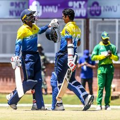 Ravindu Rashantha of Sri Lanka celebrates a century during the ICC U19 Cricket World Cup Plate Quarter Final 1 match between Sri Lanka and Nigeria at Ibbies Oval on January 27, 2020 in Potchefstroom, South Africa.