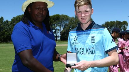Dan Mousley of England receives the player of the match award from tournament director Sivuyile Mqingwana during the ICC U19 Cricket World Cup Plate Quarter Final 2 match between England and Japan at Witrand Oval on January 27, 2020.