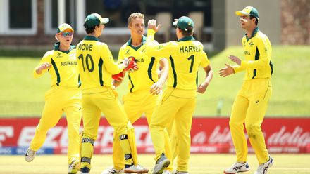 Connor Sully of Australia celebrates a wicket with team mates during the ICC U19 Cricket World Super League Cup Quarter Final 1 match between India and Australia at JB Marks Oval on January 28, 2020 in Potchefstroom, South Africa.