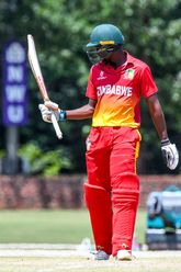 Emmanuel Bawa of Zimbabwe celebrates his century during the ICC U19 Cricket World Cup Plate Quarter Final 3 match between Zimbabwe and Canada at Ibbies Oval on January 28, 2020 in Potchefstroom, South Africa.