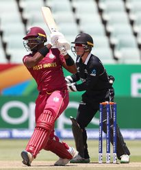 Matthew Forde of West Indies hits the ball towards the boundary, as Quinn Sunde of New Zealand looks on during the ICC U19 Cricket World Super League Cup Quarter Final match between West Indies and New Zealand at Willowmoore Park on January 29, 2020.