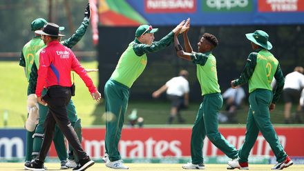 Mondli Khumalo of South Africa celebrates a run out with Bryce Parsons of South Africa during the ICC U19 Cricket World Super League Cup Quarter Final 3 match between Bangladesh and South Africa at JB Marks Oval on January 30, 2020.