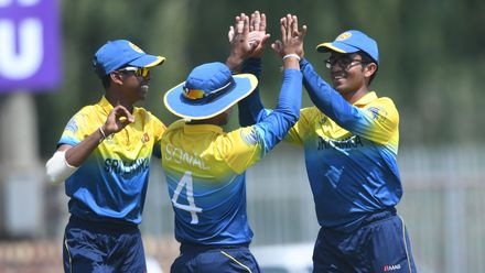 Sonal Dinusha and Ravindu Rasantha of Sri Lanka celebrate the wicket of Ben Davidson of Scotland during the ICC U19 Cricket World Cup Plate Semi-Final match at Absa Puk Oval on January 30, 2020.