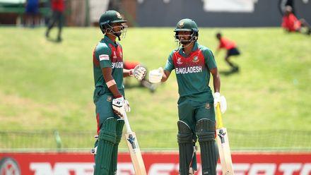 Mohammad Tawhid Hridoy of Bangladesh and Shahadat Hossain of Bangladesh celebrate a half century partnership.