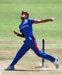 Fazalhaq Farooqi of Afghanistan in action during the ICC U19 Cricket World Super League Quarter Final match between Afghanistan and Pakistan at Willowmoore Park on January 31, 2020 in Benoni, South Africa.