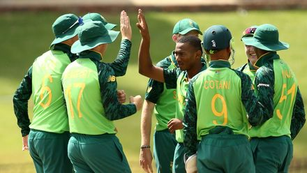 Pheko Moletsane of South Africa celebrates taking a wicket with team mates during the ICC U19 Cricket World Super League Play-Off Semi-Final match between West Indies and South Africa at JB Marks Oval on February 01, 2020 in Potchefstroom, South Africa.