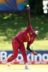 Joshua James of West Indies bowls during the ICC U19 Cricket World Super League Play-Off Semi-Final match between West Indies and South Africa at JB Marks Oval on February 01, 2020 in Potchefstroom, South Africa.