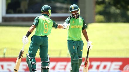 Levert Manje of South Africa celebrates his half century with bating partner Khanya Cotani of South Africa during the ICC U19 Cricket World Super League Play-Off Semi-Final match between West Indies and South Africa at JB Marks Oval on February 01, 2020.