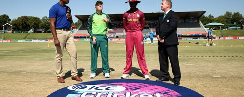 Bryce Parsons of South Africa tosses the coin during the ICC U19 Cricket World Super League Play-Off Semi-Final match between West Indies and South Africa at JB Marks Oval on February 01, 2020 in Potchefstroom, South Africa.