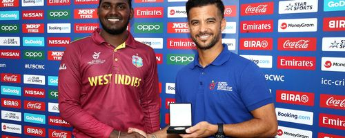 Matthew Patrick of West Indies receives the player of the match award from JP Duminy during the ICC U19 Cricket World Super League Play-Off Semi-Final match between West Indies and South Africa at JB Marks Oval on February 01, 2020 in Potchefstroom.