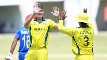 Liam Scott and Oliver Davies of Australia celebrate the wicket of Imran Mir of Afghanistan during the ICC U19 Cricket World Cup Super League Play-Off Semi-Final match between Australia and Afghanistan at Absa Puk Oval on February 2, 2020.