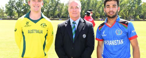 Mackenzie Harvey of Australia, match referee Phil Whitticase and Farhan Zakhail of Afghanistan during the ICC U19 Cricket World Cup Super League Play-Off Semi-Final match between Australia and Afghanistan at Absa Puk Oval on February 2, 2020.