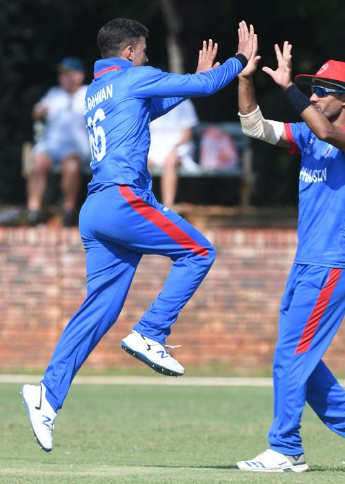 Abdul Rahman of Afghanistan celebrates the wicket of Oliver Davies of Australia during the ICC U19 Cricket World Cup Super League Play-Off Semi-Final match between Australia and Afghanistan at Absa Puk Oval on February 2, 2020 in Potchefstroom.