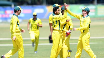Tanveer Sangha of Australia celebrates the wicket of Sediqullah Atal of Afghanistan with his team mates during the ICC U19 Cricket World Cup Super League Play-Off Semi-Final match between Australia and Afghanistan at Absa Puk Oval on February 2, 2020.