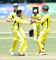 Tanveer Sangha and Patrick Rowe of Australia celebrate the wicket of Sediqullah Atal of Afghanistan during the ICC U19 Cricket World Cup Super League Play-Off Semi-Final match between Australia and Afghanistan at Absa Puk Oval on February 2, 2020.